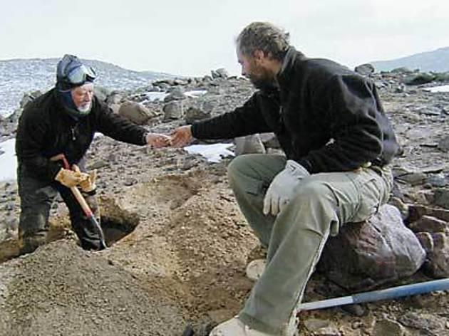 ROCK STARS Geologists evaluate the polar terrain.