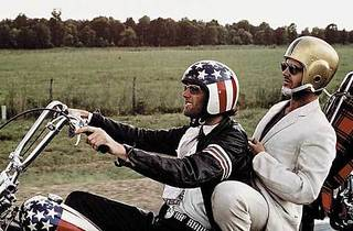 BSTARS AND STRIPES FOREVER Fonda and Nicholson raise some helmet.