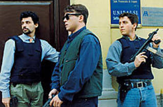 VESTED INTERESTS Lo Verso, Amendola and Memphis, from left, serve and protect.