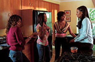 KITCHEN CONFIDENTIAL Lathan, far right, compares notes with the ladies.