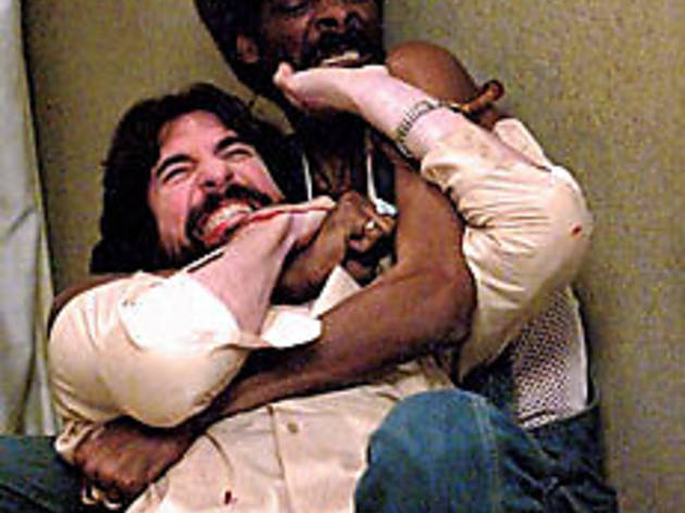 ROUGH WRITERS McDermott, left, and Snoop Dogg tussle.