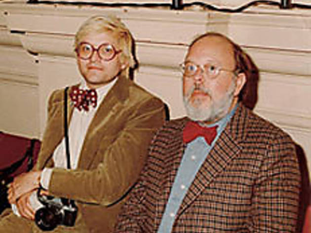 BOW-TIED AND BOUND Geldzahler, right, hangs with David Hockney.