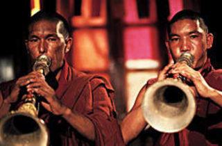 BLOW OUT Tibetan monks make some noise.