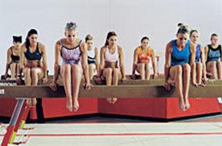 BALANCE OF POWER Gung-ho gymnasts beam with pride.