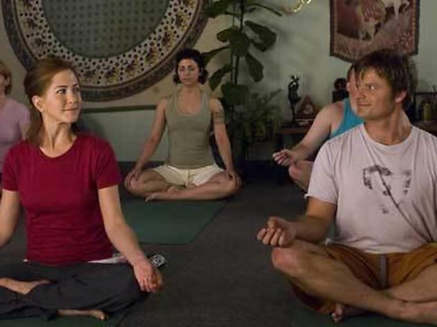 FEEL THE BURN Aniston practices yoga, Zahn flirting.