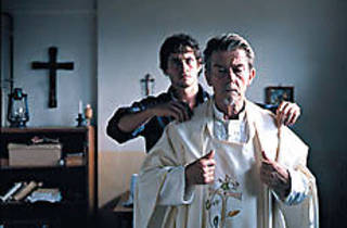 DO THE WHITE THING John Hurt, foreground, is redeemed.