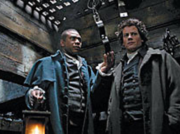 BREAK THOSE CHAINS Gruffudd, right, inspects a slave ship's shackles.