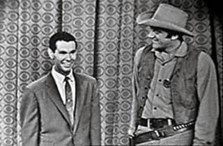 JOHNNY ON THE SPOT Carson, left, and James Arness plug the debut of Gunsmoke