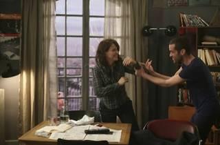SAY CHEZ! Binoche and Duris goof around in his apartment.