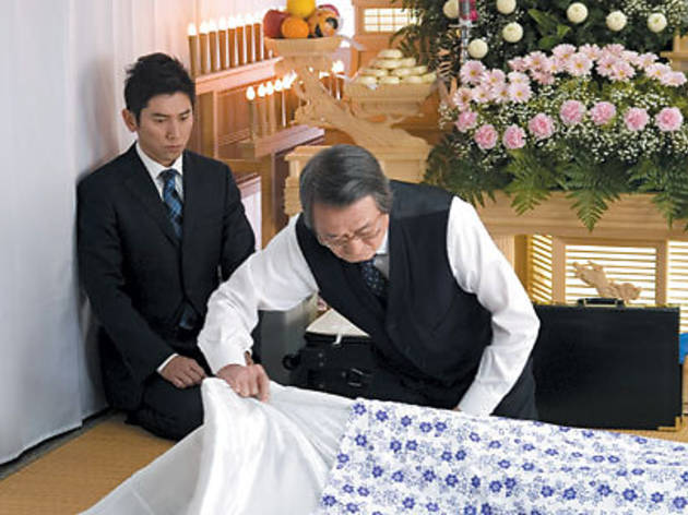 DEATH BECOMES YOU Motoki, left, learns from mortician Yamazaki.