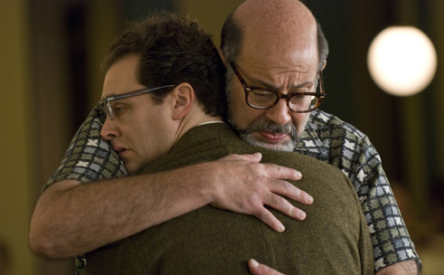 HUG IT OUT Melamed, right, takes more from Stuhlbarg than body heat.