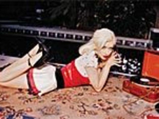 DISC JOCKEY Aguilera hangs up her assless chaps.