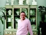What a bust: Gentet poses in front of his collection of white dishes and statues