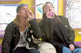 PARTY ANIMALS Jason Mewes, left, and Smith toot their own horns.