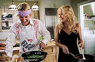 OWEN WORST ENEMY Wilson, left, cooks up a recipe for disaster.