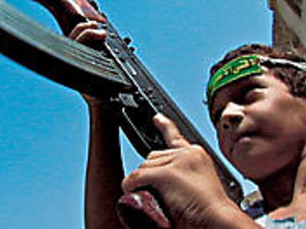 YOUTH BRIGADE An Iraqi child hoists his father's AK-47.