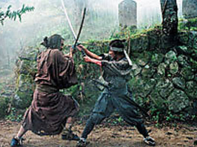 CROSSED SWORDS Ozawa, left, and Nagase fight to the finish.