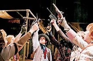 SIX-GUN SALUTE The Dandies raise their pistols high.