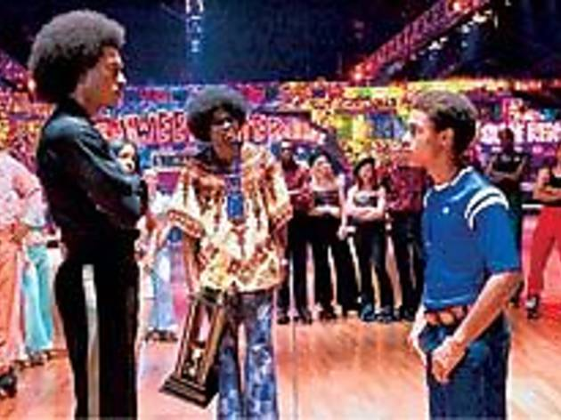 AFRO-CENTRIC Roller-boogier Bow Wow, right, squares off against a well-coiffed rival.