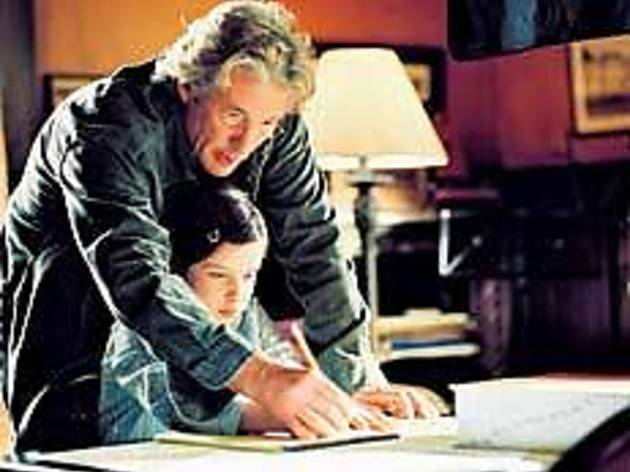 HOW DO YOU SPELL SMOTHERING? Gere hovers over his daughter's studies.