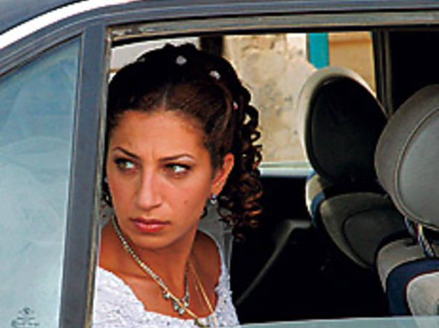 RUNAWAY BRIDE Khoury catches a ride to the Syrian border.
