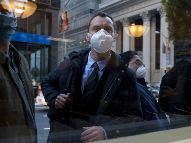 Jude Law, center, in Contagion