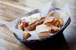 "Little Town NYC The menu at Little Town NYC is an ode to the Empire State's hyperregional specialties, and the conceptual shtick yields some tasty, and singular snacks. There's the Rochester ""Garbage Plate"" (a two-person, $14 platter of tater tots, topped"