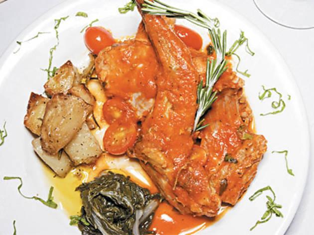 Braised rabbit in herbed tomato sauce