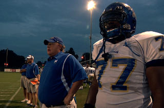 Coach Bill Courtney, left, and O.C. Brown in Undefeated