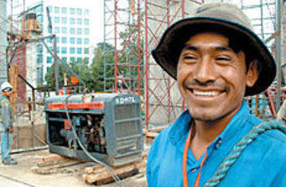 EVE OF CONSTRUCTION Smiles can't mask hellish conditions.