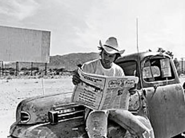 X MAN Doe scans the headlines.