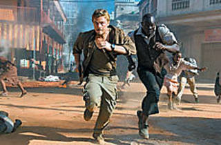 RIOT ACT DiCaprio and Hounsou take cover.