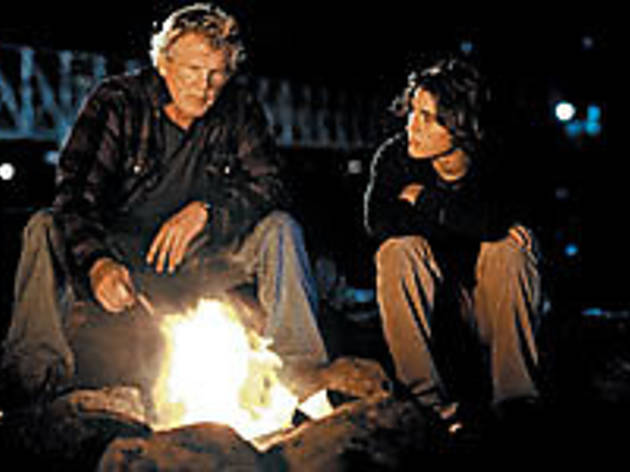 FLAMED OUT Nolte, left, and Morgan trade campfire tales.