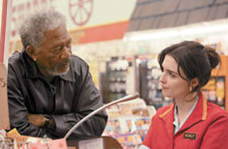 CHECKED OUT Freeman, left, admires Vega's customer service.