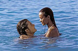MAKING WAVES Bloom and Saldana enjoy a secret dip.