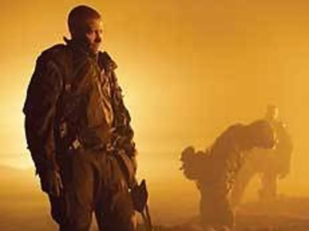 LUBE JOB Gyllenhaal gets oiled down in the desert.