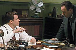 DESK SET Partners Travolta, left, and Gandolfini mull over their leads.
