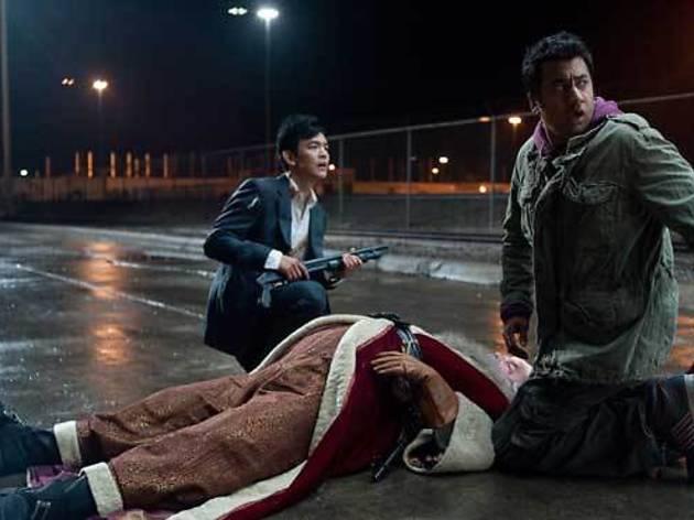 John Cho, left, Kal Penn and Richard Riehle in A Very Harold & Kumar 3D Christmas