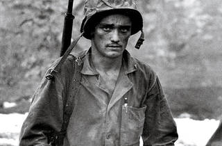 PACIFIC OVERTURES An American soldier digs in his heels on the island of Saipan.