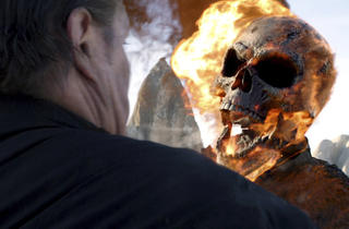 A hotheaded Nicolas Cage, right, in Ghost Rider: Spirit of Vengeance