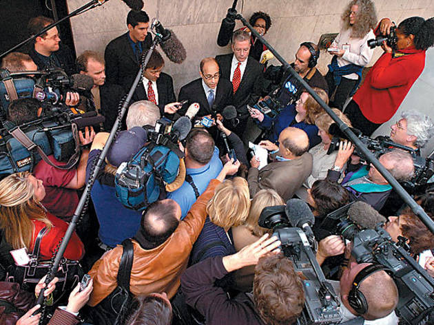 FULL COURT PRESS Reporters mob the pro-evolution attorneys.