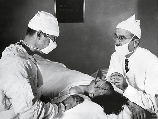 HEAD GAMES Freeman, right, probes a patient's skull.