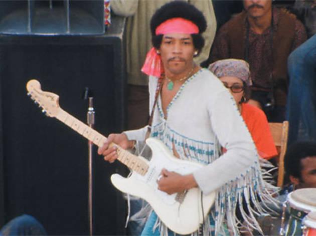 FRINGE BENEFITS Hendrix models a cool jacket, plays some hot licks.