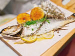 Salt-crusted branzino