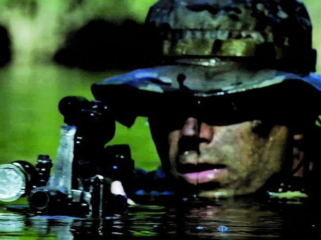 A Navy SEAL moves in for the kill in Act of Valor