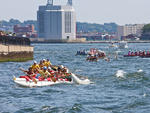 Watch a race around the harbor and fete the winners at a luau for the Liberty World Outrigger Competition