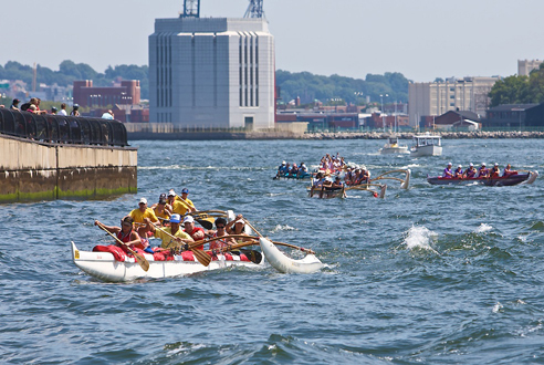 Watch a race around the harbor and fete the winners at a luau