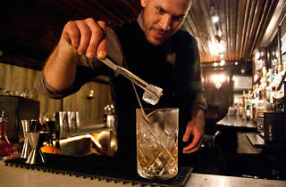 Bartender Jason Littrell making an Oaxaca old-fashioned at Death & Co