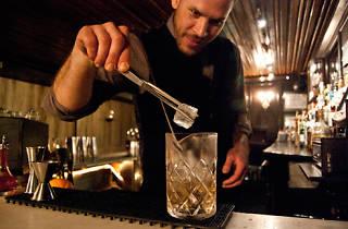 Bartender Jason Littrell making an Oaxaca old-fashioned at Death & Co