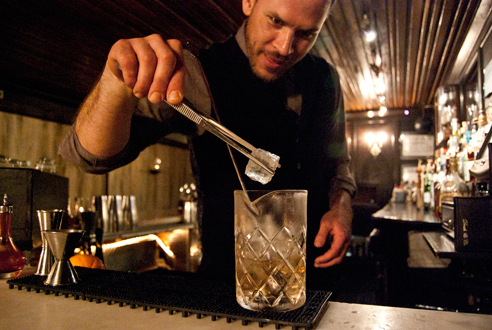 Bartender Jason Littrell making an Oaxaca old-fashioned at Death & Company